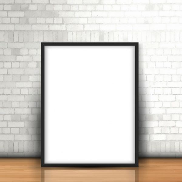 Blank picture leaning against brick wall (Turbo Premium Space)